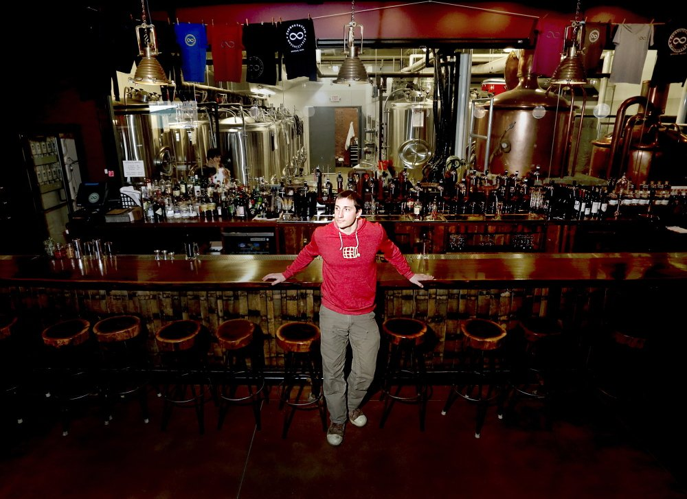 """Eric Michaud, owner of the In'finiti brewery and restaurant in Portland, said when he put the alcohol content on a beer festival poster """"it wasn't a way to advertise, 'Come get drunk.' """""""