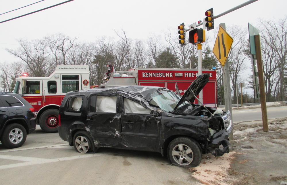 An Arundel woman and two children were slightly injured when this Honda Pilot left a road, hit a retaining wall and rolled over Monday.