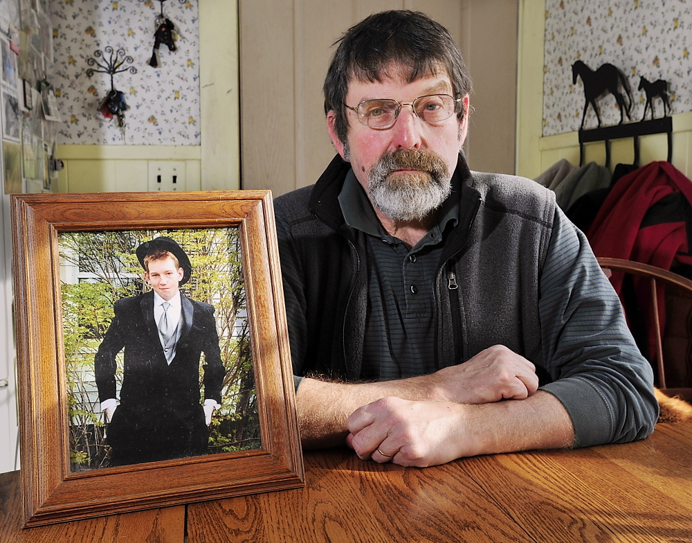 """Henry """"Skip"""" Gates, of Skowhegan, sits next to a photo of his son, Will, who died after snorting heroin at college. Gates plans to testify in favor of a Narcan-access bill."""