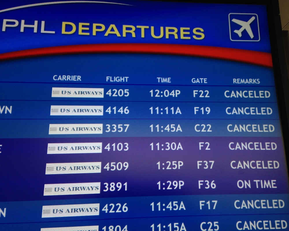The departure board at the Philadelphia International Airport shows canceled flights on Monday.