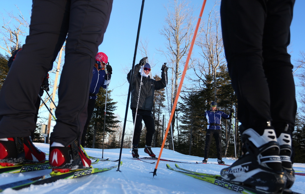 Will Sweetser of the Maine Winter Sports Center leads skiers through a workout at the Nordic Heritage Center in Presque Isle. Six athletes who trained at the center will compete in the Winter Olympics in Sochi, Russia.