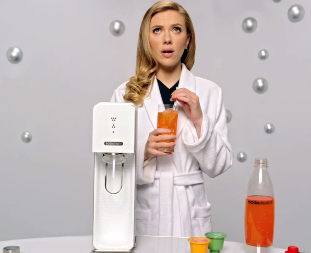 Scarlett Johansson appears in SodaStream's 2014 Super Bowl ad promoting its soda-making machine. Green Mountain Coffee Roasters has a competing machine in the works.