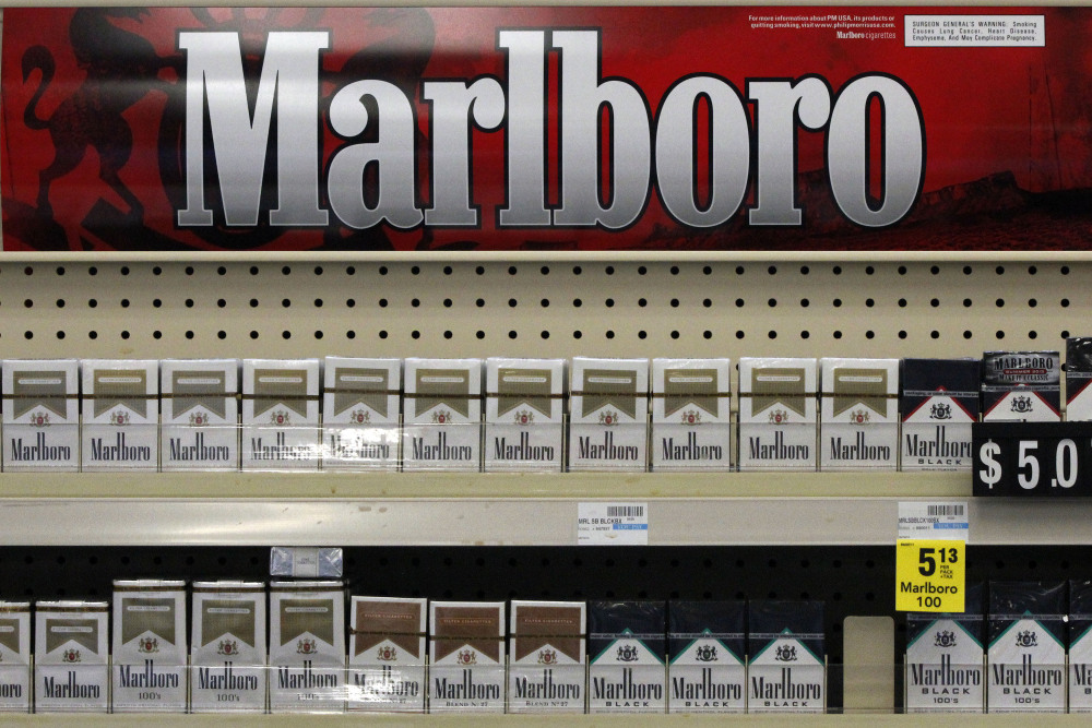 Marlboro cigarettes are on display in a CVS store in Pittsburgh. The move to phase out cigarettes, cigars and chewing tobacco by Oct. 1 will cost the nation's second-largest drugstore chain about $2 billion in annual revenue.
