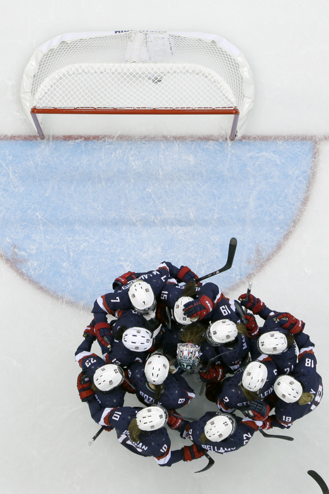 The USA women's hockey team celebrates its 3-1 win over Finland during at the Shayba Arena during the 2014 Winter Olympics, Saturday, Feb. 8.