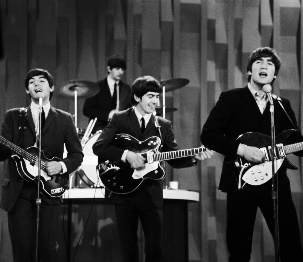 """In this Feb. 9, 1964 photo, The Beatles, from left, Paul McCartney, Ringo Starr on drums, George Harrison and John Lennon, perform for the CBS """"Ed Sullivan Show"""" in New York, as they record a set that would later be shown on the Feb. 23 broadcast of the show. The Beatles made their first broadcast appearance on """"The Ed Sullivan Show,"""" America's must-see weekly variety show, later in the day, Sunday, Feb. 9, 1964, officially kicking off Beatlemania."""