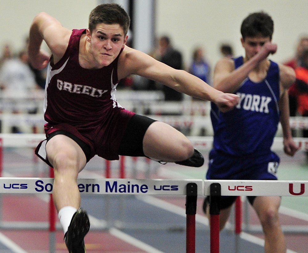 Chance Call of Greely clears a hurdle on his way to victory in the senior 55 hurdles with a time of 8.55 seconds.