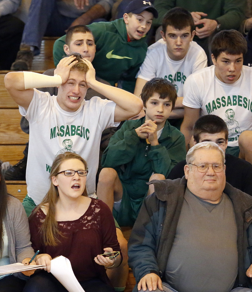 Logan Martin, a wrestler for Massabesic, can't contain his emotion as he watches his teammate, Trevor Walton, take on Bonny Eagle's Robert Martin during the Western Class A regional at Sanford High.