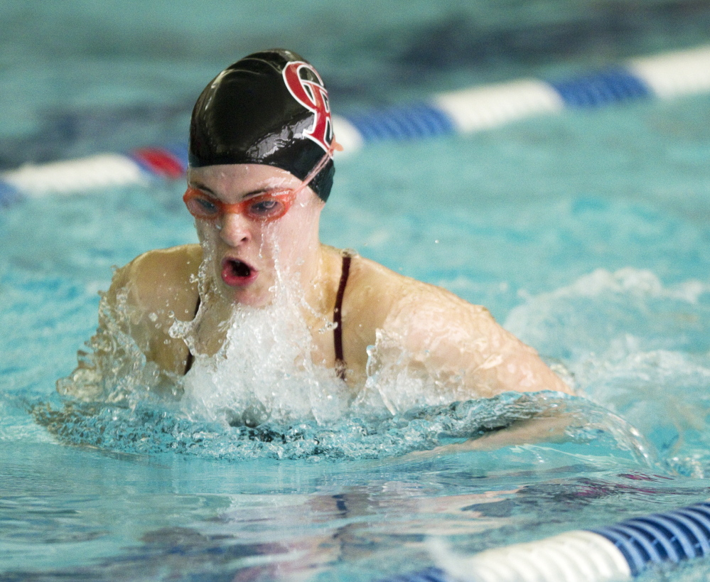 Sadie Stiles of Cape Elizabeth swims the breast stroke leg of the opening 200-yard medley relay, helping the Capers win the event,