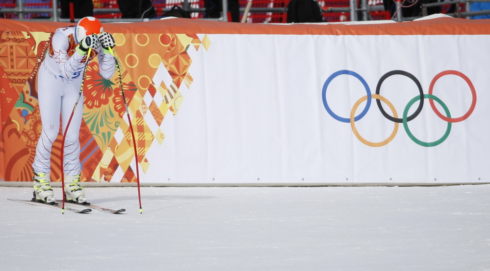 Bode Miller could only hang his head after competing in the men's Alpine downhill race at the Sochi Olympics on Sunday. A few minor mistakes took him out of medal contention after strong training runs earlier in the week had put him among the favorites.