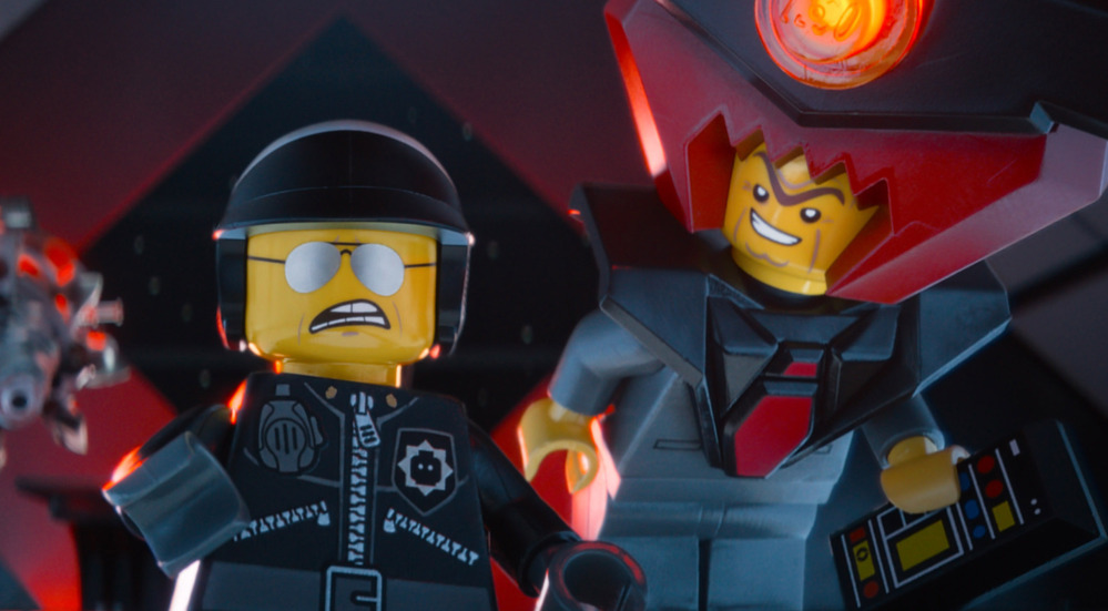 """This image from """"The Lego Movie"""" shows the character Bad Cop/Good Cop, voiced by Liam Neeson, left, and President Business, voiced by Will Ferrell, in a scene."""