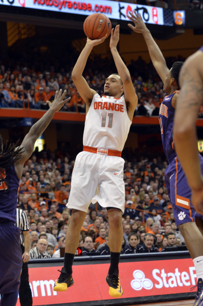 Syracuse's Tyler Ennis shoots against Clemson during the second half of an NCAA college basketball game in Syracuse, N.Y., Sunday.