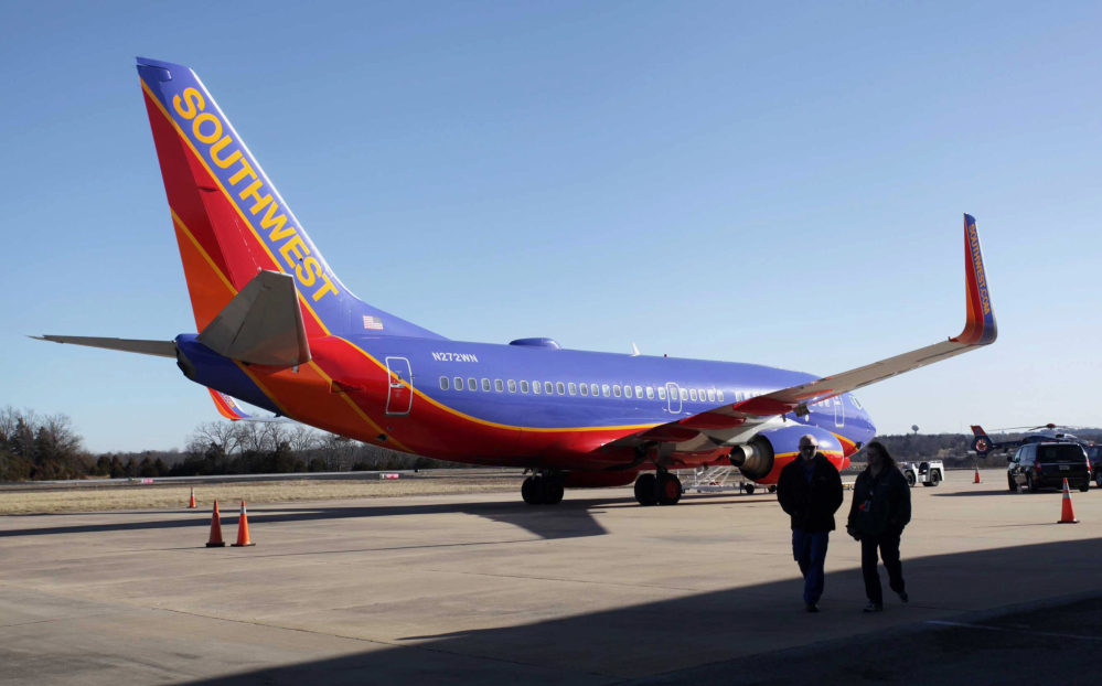 Southwest Airlines Flight 4013 sits at the M. Graham Clark Downtown Airport in Hollister, Mo., on Jan. 13. On at least 150 flights, U.S. commercial air carriers have either landed at the wrong airport or started to land and realized their mistake in time.
