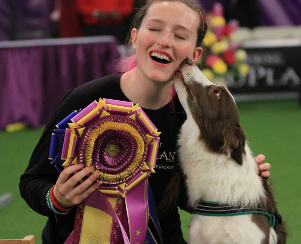 Delaney Ratner of Cape Elizabeth, with her dog Kelso, gets a ribbon and a face-lick after Kelso won the first masters agility title at Westminster.