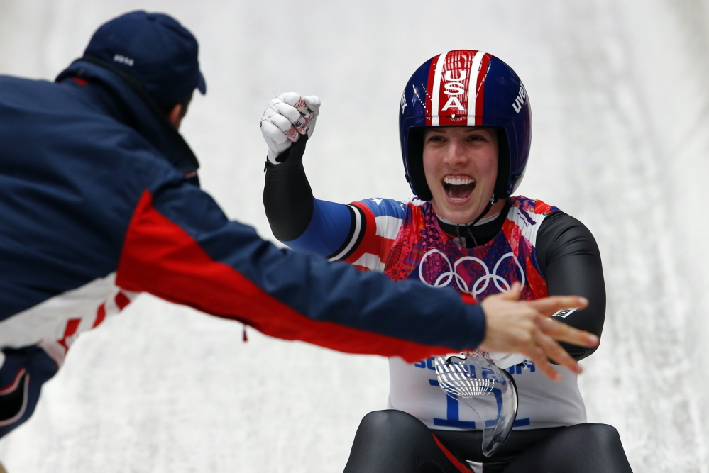 Erin Hamlin of the United States celebrates after finishing third in the women's luge – the first medal for any American singles competitor in the event in the 50-year history of women's luge at the Olympics.