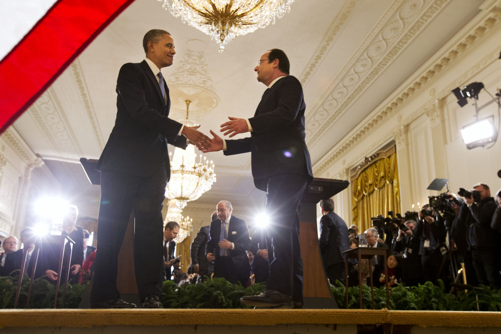 President Barack Obama shakes hands with French President Francois Hollande after their news conference in the East Room of the White House in Washington, Tuesday.