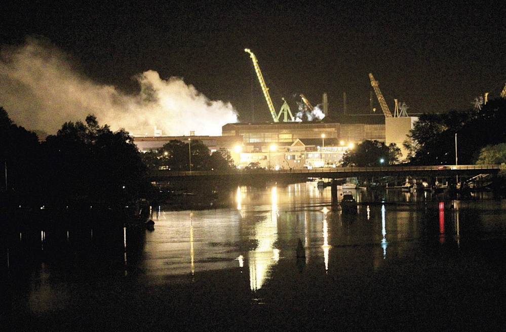 Smoke rises from a dry dock as crews respond to a fire on the USS Miami submarine at the Portsmouth Naval Shipyard in Kittery on May 23, 2012.