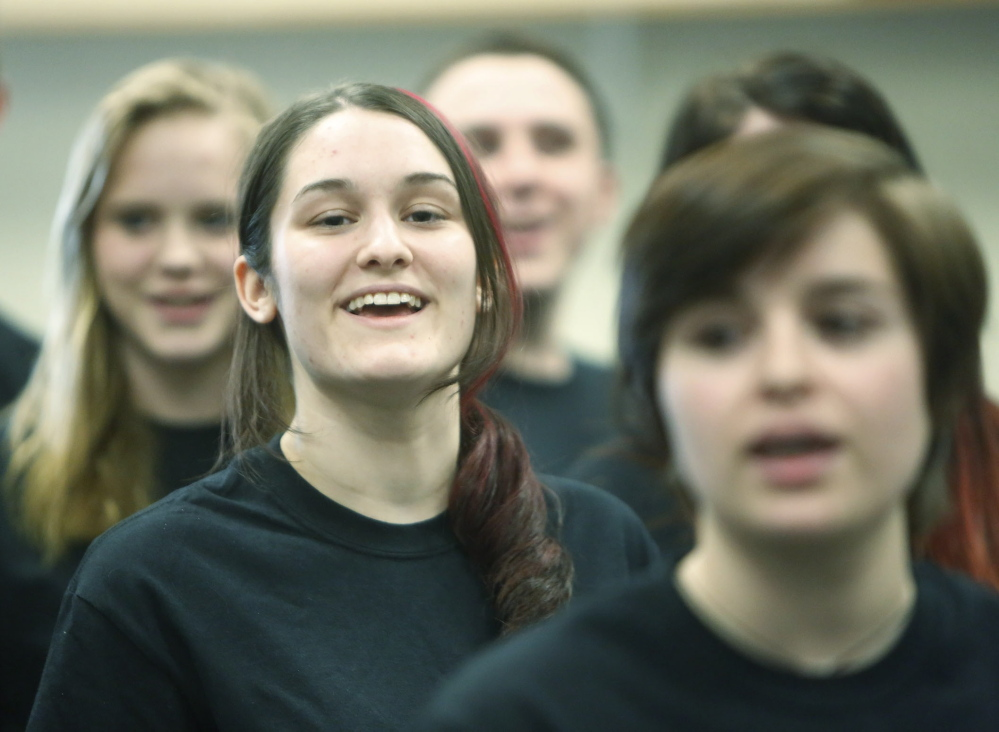 Gregory Rec/Staff Photographer Junior Christina Taylor, center, and other members of the Deering High School choir rehearse the Foreigner song
