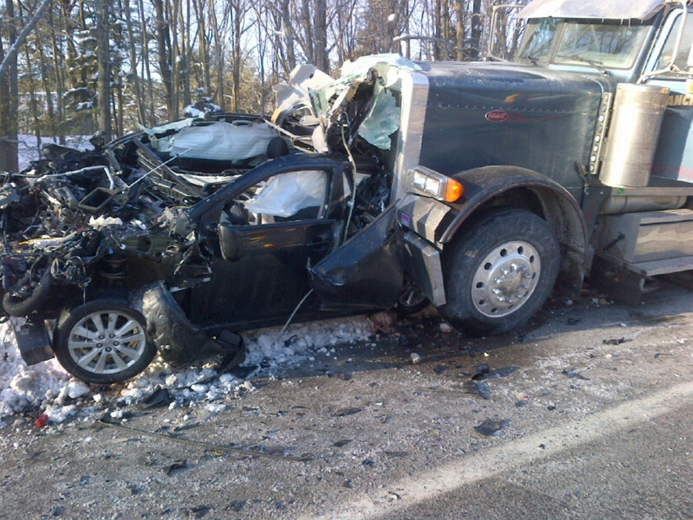 A woman was able to walk away without significant injury after her Toyota Corolla was sandwiched between a tanker truck and a pickup truck in South Portland on Tuesday.