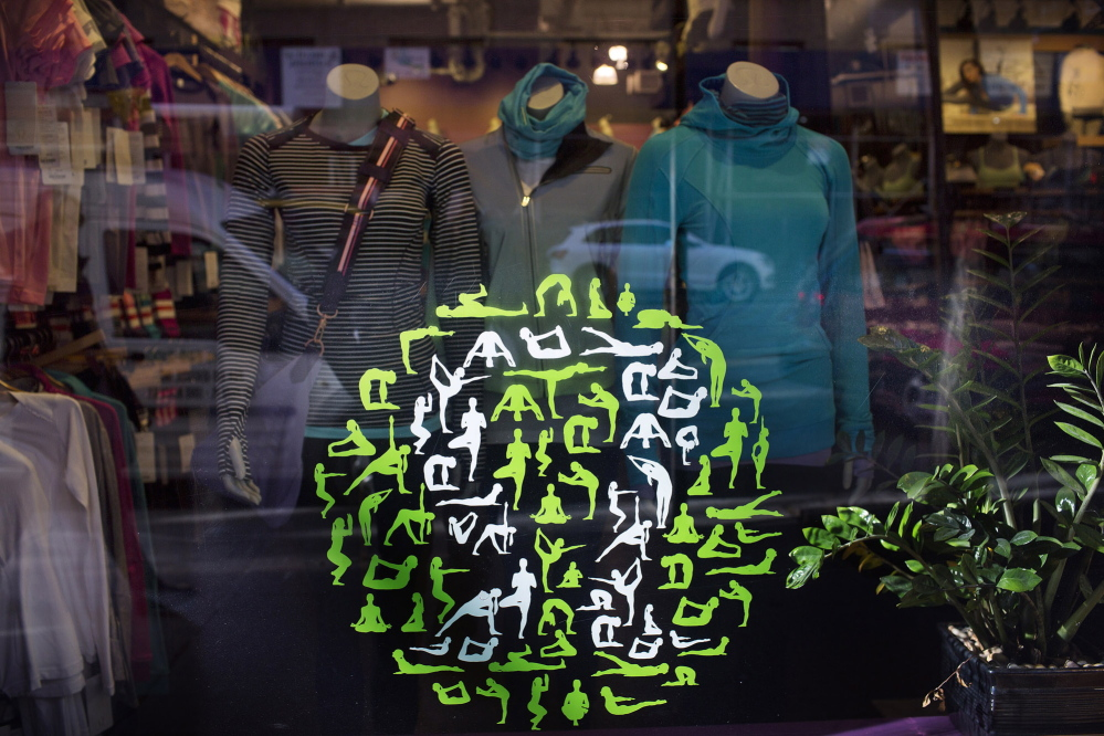 Lululemon workout clothes are displayed in New York City. Lululemon helped making activewear popular by applying a feminine touch to a once-male-oriented category.