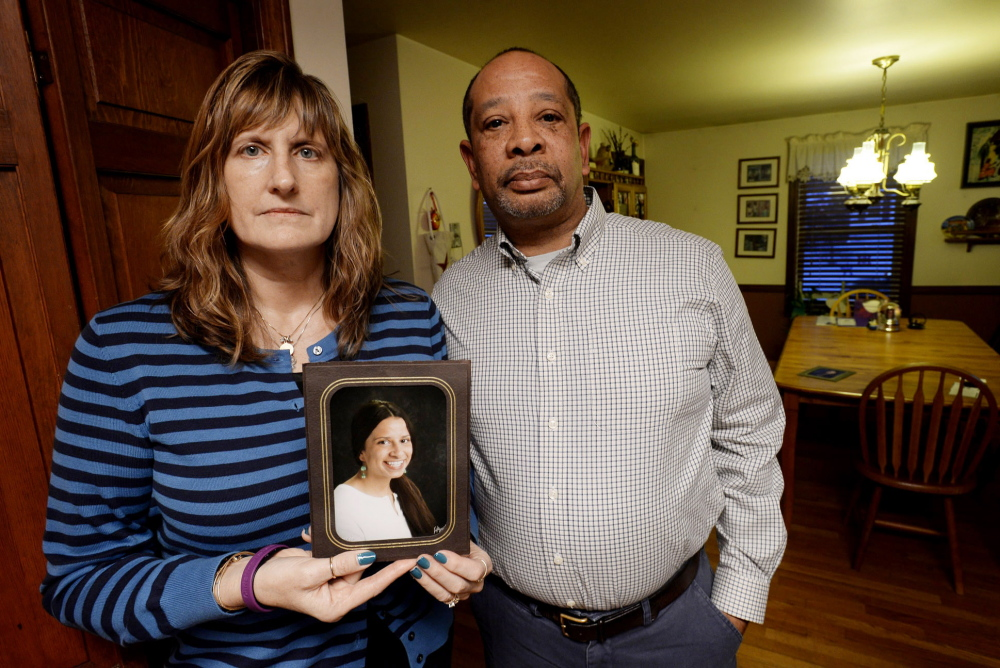 Judith and Wayne Richardson, the parents of Darien Richardson, whose murder in 2010 remains unsolved, hold a photograph of Darien.
