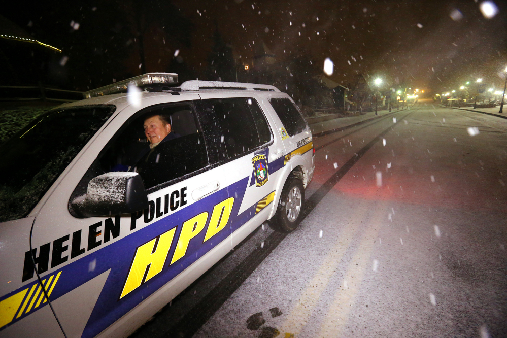 Helen police officer Lee Johannsen in his four-wheel drive vehicle is the only thing moving through the Alpine City of Helen, Ga., in the Southern Appalachian Mountains on Wednesday.