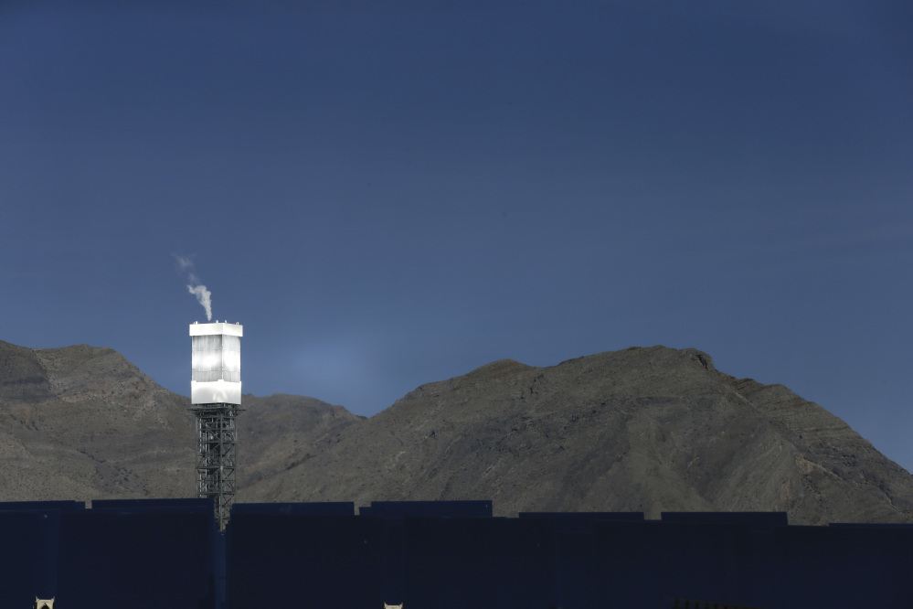 A boilers sits on 459-foot towers vents steam recently in Primm, Nev. The Ivanpah Solar Electric Generating System, sprawling across roughly 5 square miles of federal land near the California-Nevada border, opened formally Thursday after years of regulatory and legal tangles.