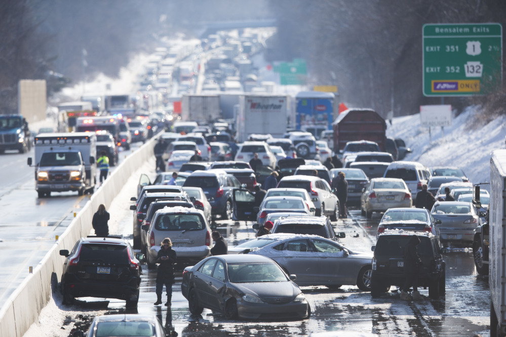 Vehicles are piled up in an accident Friday in Bensalem, Pa. The accident outside Philadelphia and caused some injuries.