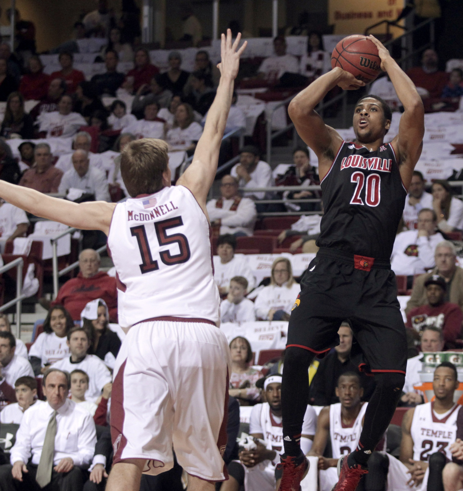 Louisville's Wayne Blackshear shoots over Temple's Jimmy McDonnell during the first half of Friday's game at Philadelphia, won by Louisville 82-58.