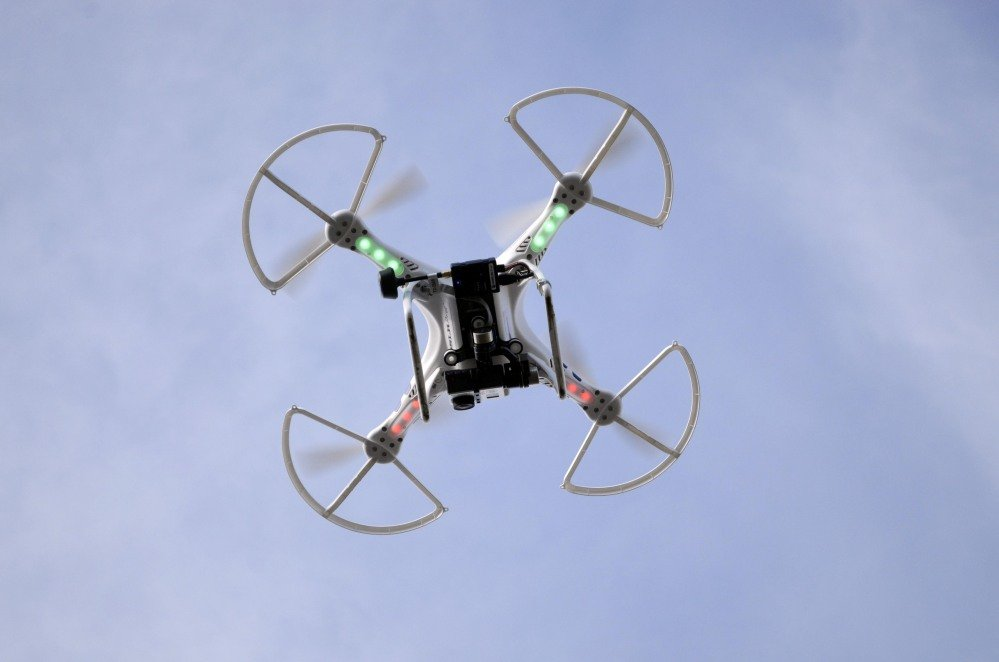An aerial drone with a high quality video camera records the landscape of the Berkshire Equestrian Center in Richmond, Mass. Drone use for commercial purposes is forbidden in the U.S., but enforcement ranges from lax to non-existent.