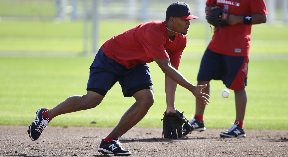 Infielder Xander Bogaerts, the former Sea Dog who could be the Red Sox shortstop this season, fields a grounder during an early workout Saturday in Fort Myers, Fla.