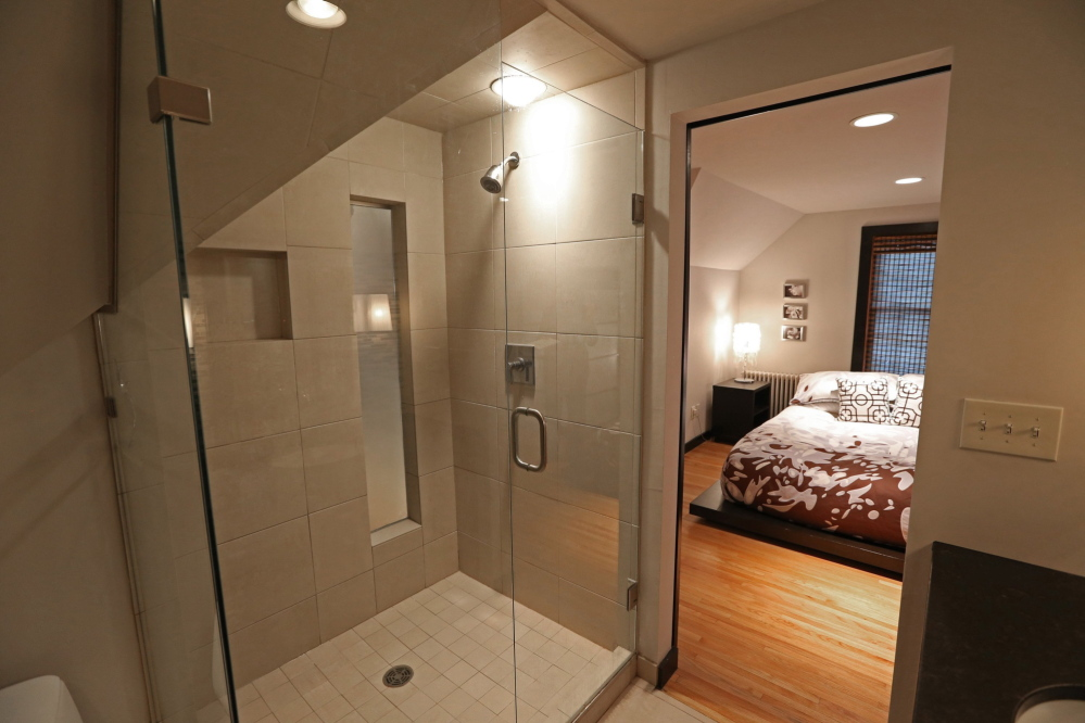 A custom oversized tiled shower was carved into the bathroom.