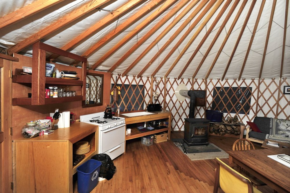 Yurts have an unusual wall and roofing system and a dome that lets in light. The yurt is built on decks of hardwood.