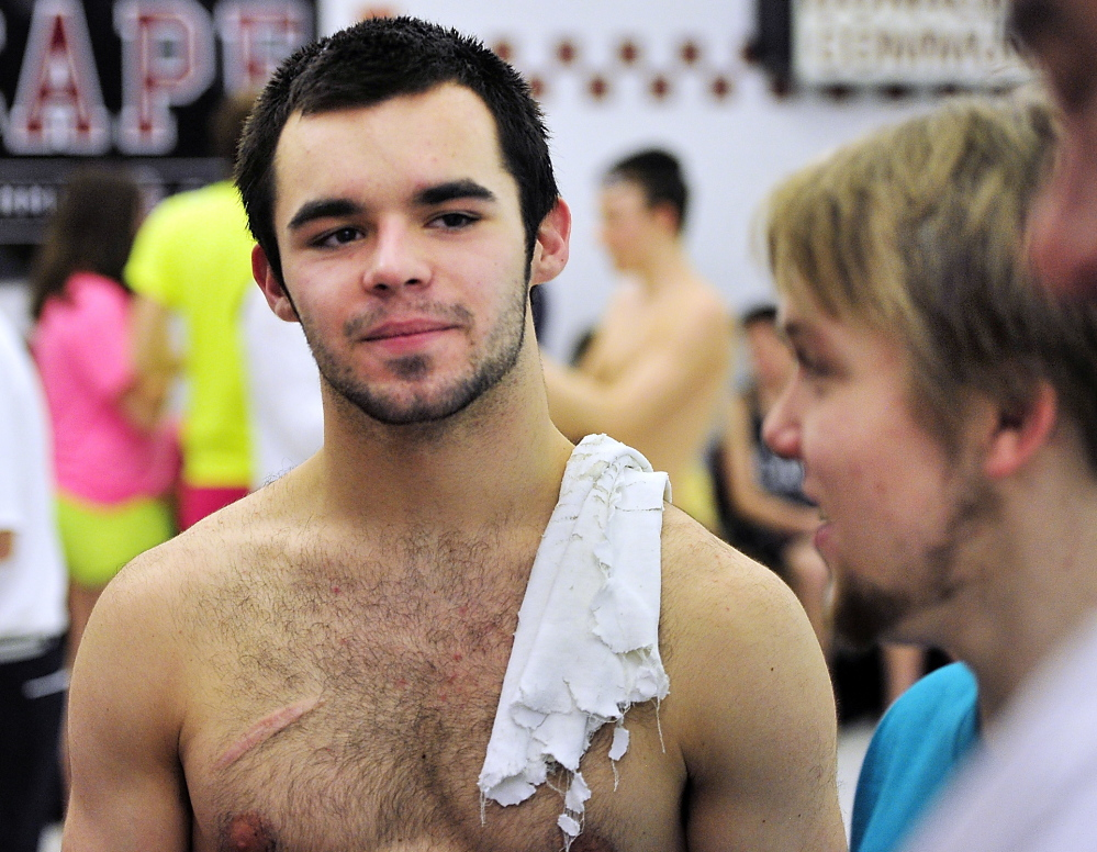 Cheverus senior Nick Jensen talks with friends after winning the diving event in December at the Southwesterns North boys' swim championships at Cape Elizabeth High School .
