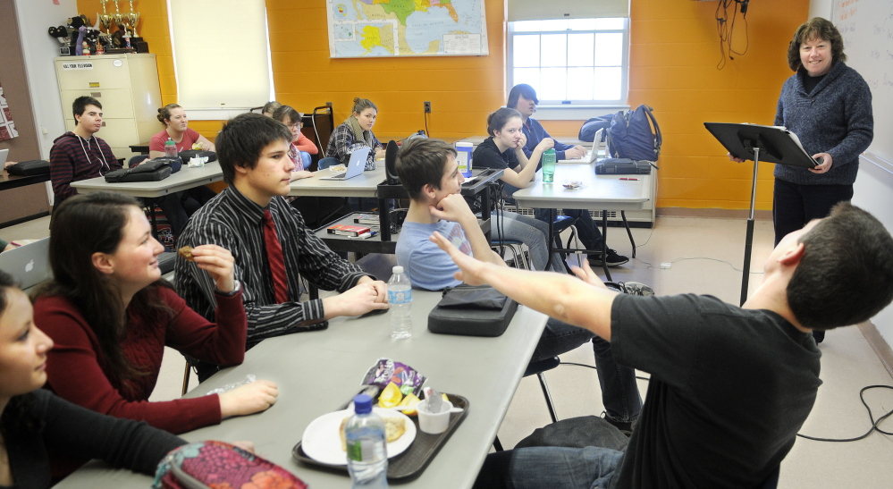 Teacher Cathy Foyt challenges members of Monmouth Academy's Academic Decathon team to learn the history portion for the annual contest between schools during a practice at the Monmouth school.