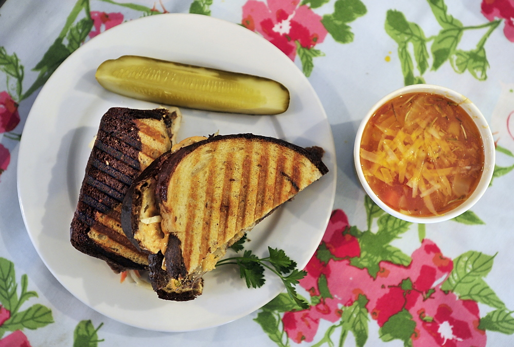 At Highland Avenue Greenhouse & Farm Market, the Reuben is made with nitrate-gree corned beef, Swiss cheese and crunchy slaw. It's shown with a side of Peasant Tuscan Soup.