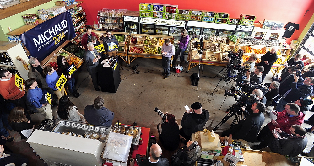 """Surrounded by supporters and media, U.S. Rep. Mike Michaud holds a news conference at Rosemont Bakery in Portland to unveil his economic plan if elected governor. """"This ... includes concrete ideas and proposals that we can start implementing on day one,"""" he said."""