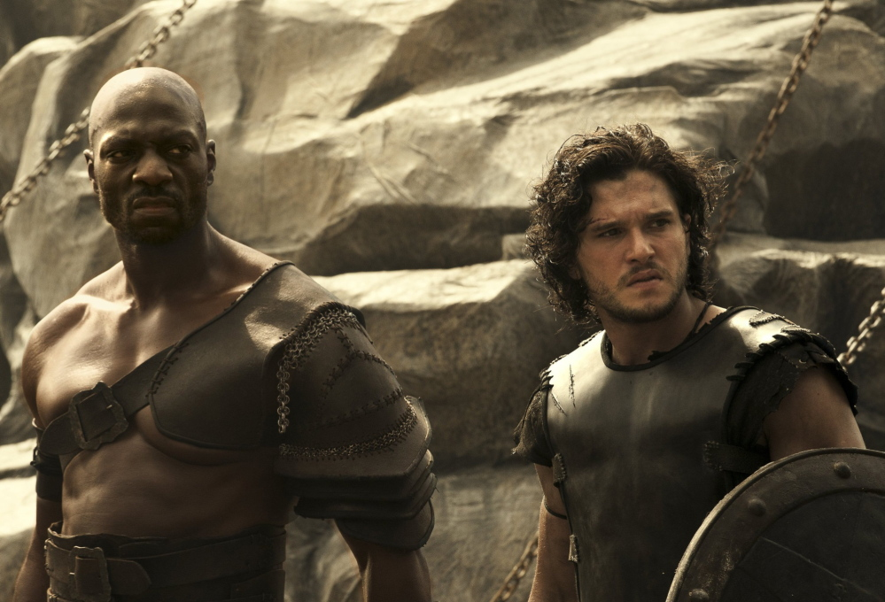 """Adewale Akinnuoye-Agbaje, left, and Kit Harington are gladiator foes who become allies in """"Pompeii."""""""