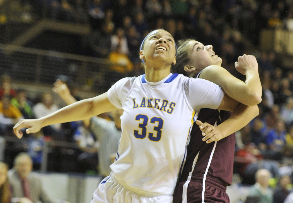 Tiana-Jo Carter, left, of Lake Region and Ashley Storey of Greely fight for rebounding position during their Western Class B girls' basketball semifinal Thursday at the Cumberland County Civic Center. Top-seeded Lake Region advanced with a 43-32 win.