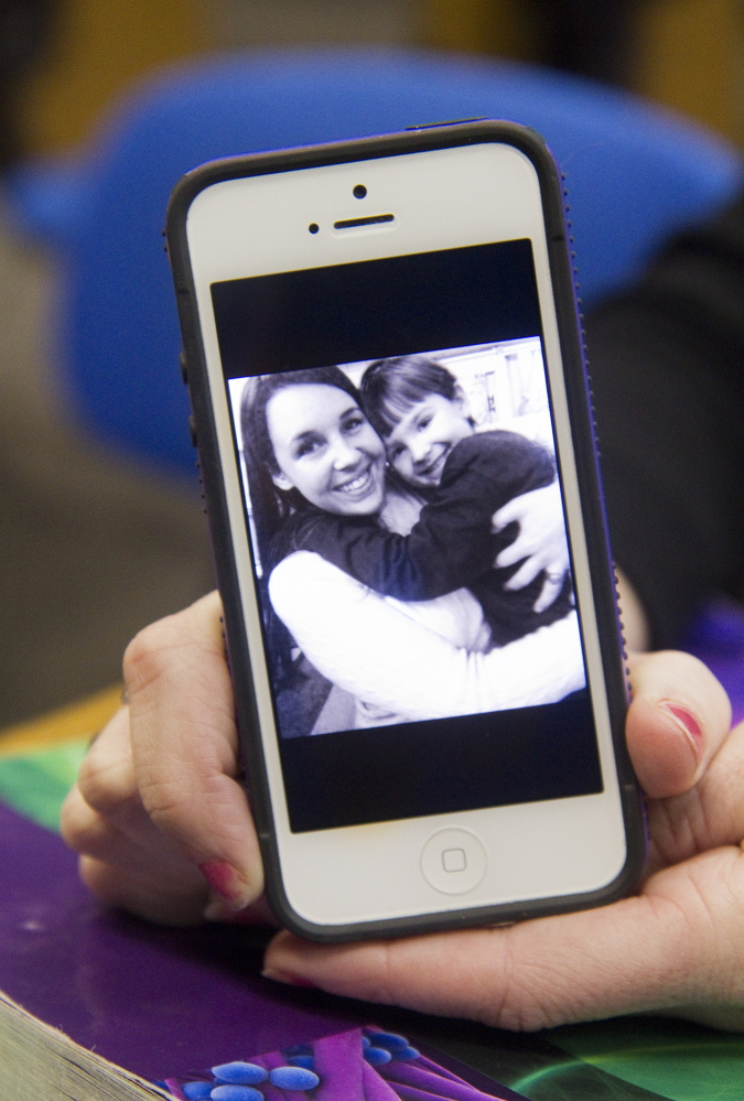 Voucher-user Ellie Fleming holds her phone with a photo of Fleming and her son Gavin, age 4, on Thursday.