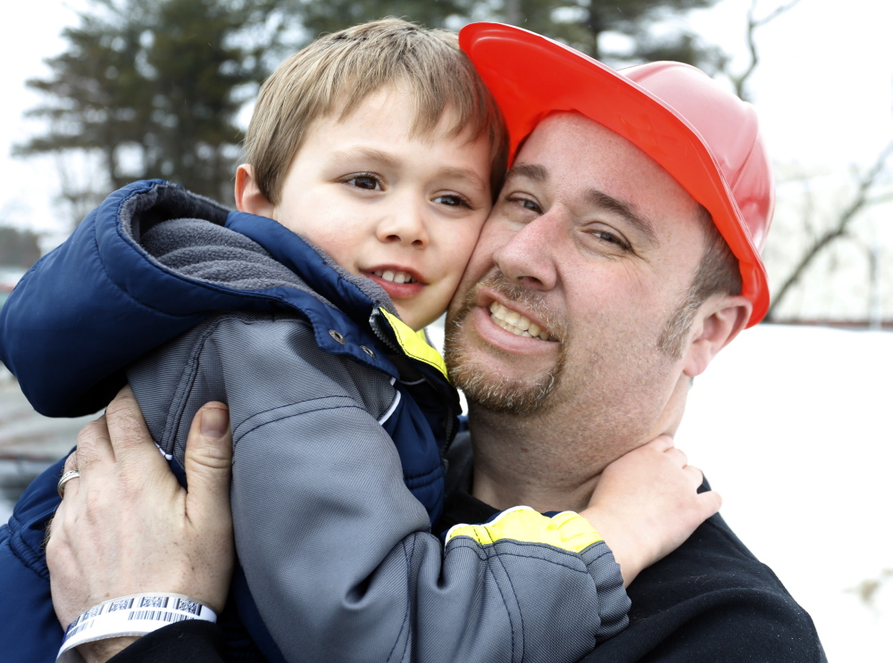 """Jon Tanguay and his son Nicholas, 4, shown together in Bath on Friday, escaped a fire Thursday at their home at 62 South St. """"I couldn't see a thing (because of the smoke),"""" Tanguay said. """"Luckily, I was able to hold him."""""""