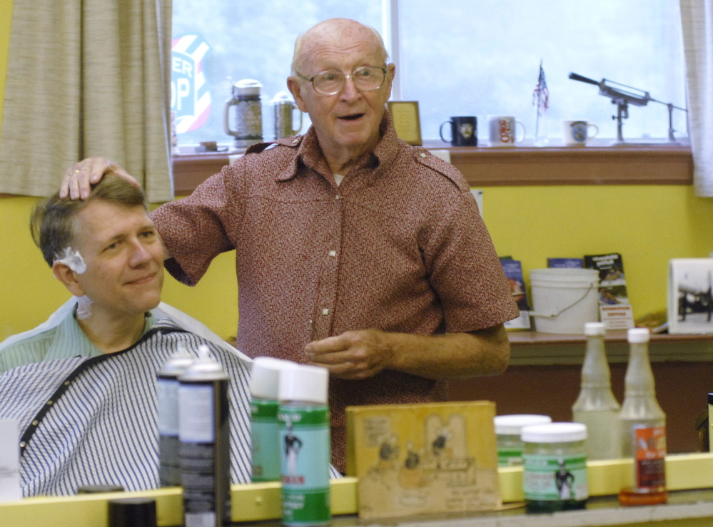 "Barber ""Red"" Soucy shares a story with Gary McNeill of Waterboro at Soucy's Saco barbershop in this 2007 photo. Soucy cut hair for nearly 60 years."