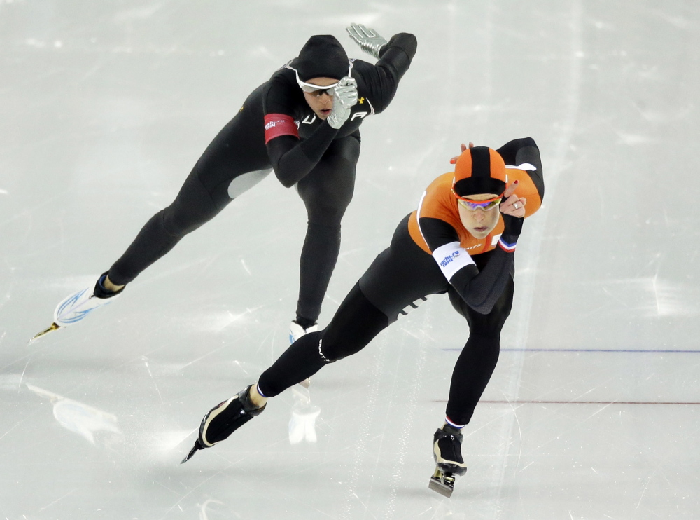 Brittany Bowe of the United States, left, trails silver medalist Ireen Wust of the Netherlands in the women's 1,000-meter speedskating race during the 2014 Winter Olympics in Sochi, Russia. After a strong season on the World Cup circuit, the U.S. speedskating team has had a miserable performance in Sochi – and much of the speculation turned to the new Under Armour skinsuit developed with help from aerospace and defense giant Lockheed Martin.