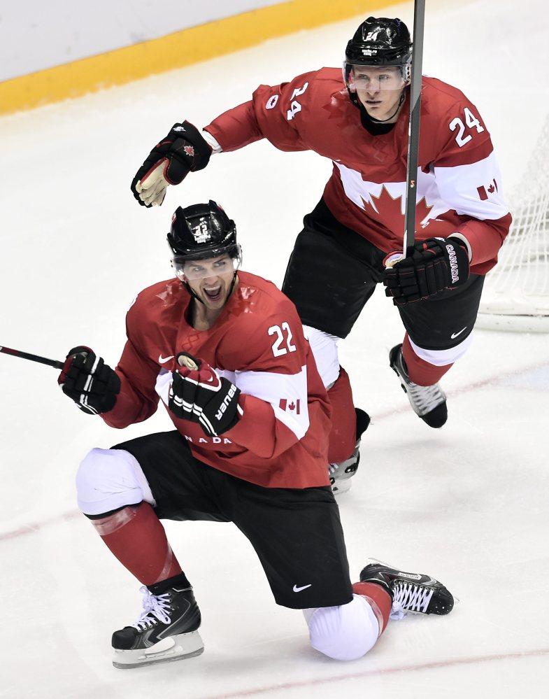 Canada's Jamie Benn celebrates with Jeff Carter ,after scoring the first goal against the United States during the second period of the hockey semifinal at the 2014 Sochi Winter Olympics in Sochi, Russia on Friday.