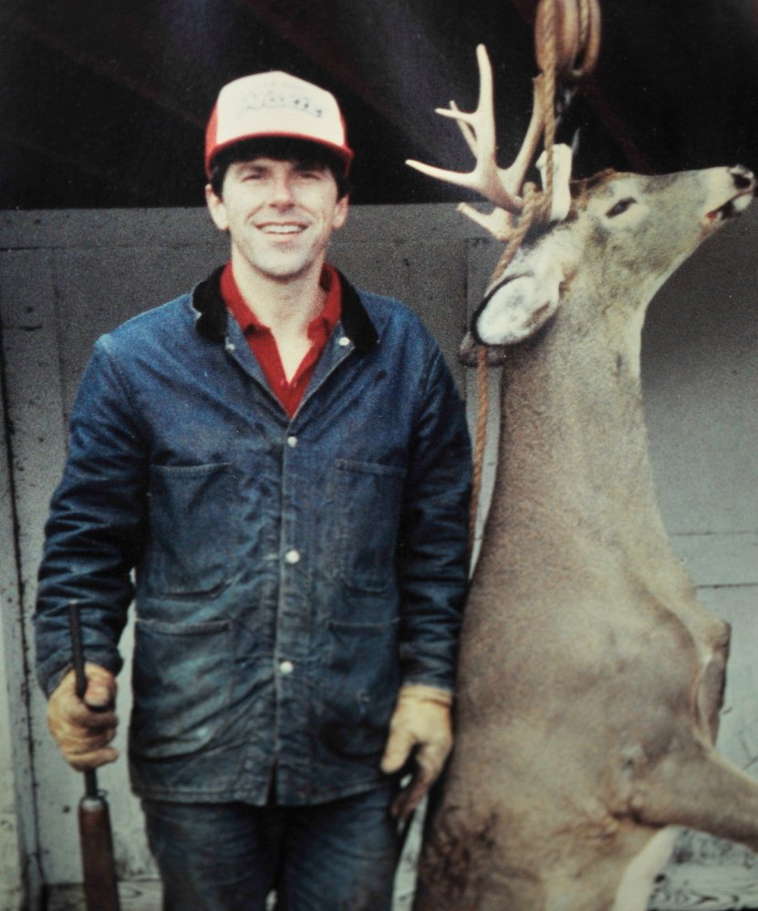 A younger Smith is pictured with a fine buck he bagged more than 30 years ago while hunting with his father, with whom he still hunts, oftentimes on the extensive woodland he owns in rural Kennebec County.