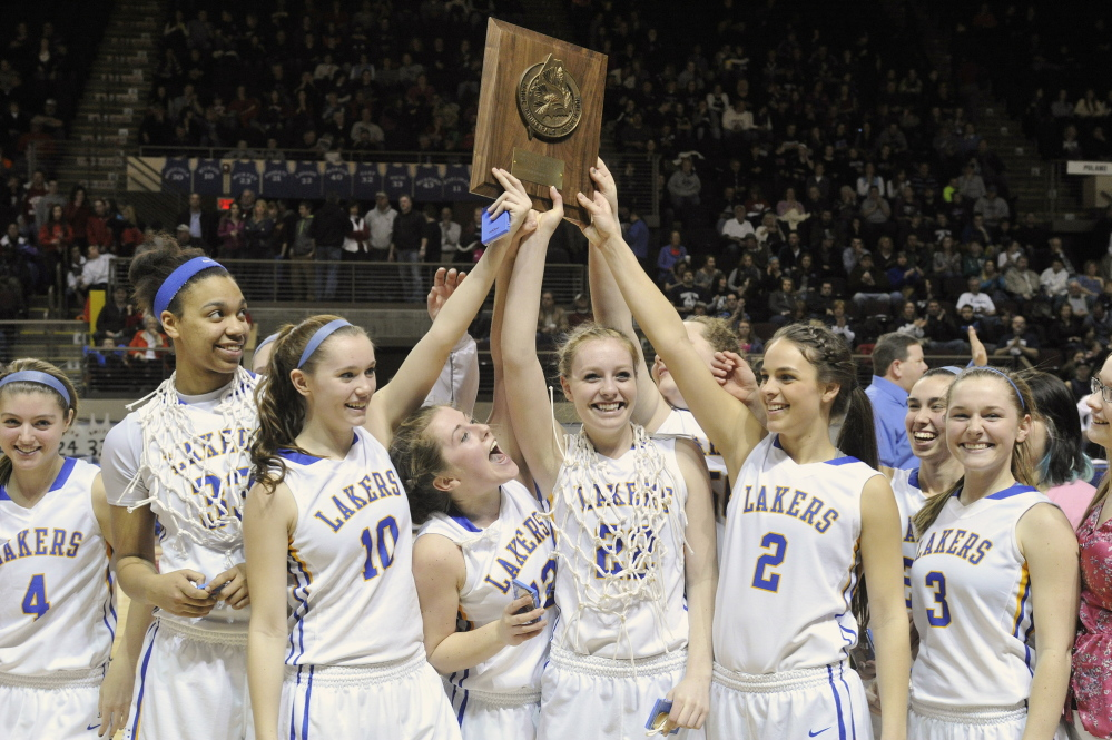 Lake Region players hold up the championship plaque after winning their third straight Western Class B title.