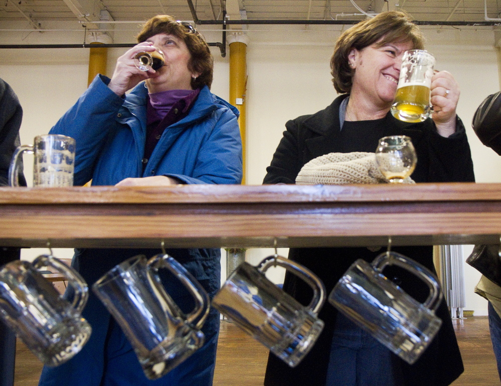 Nancy Coleman of Portland and Janice DiBona of Biddeford Pool sample brews Saturday in the Banded Horn Brewing Co. tasting room. Banded Horn Brewing just opened last year.