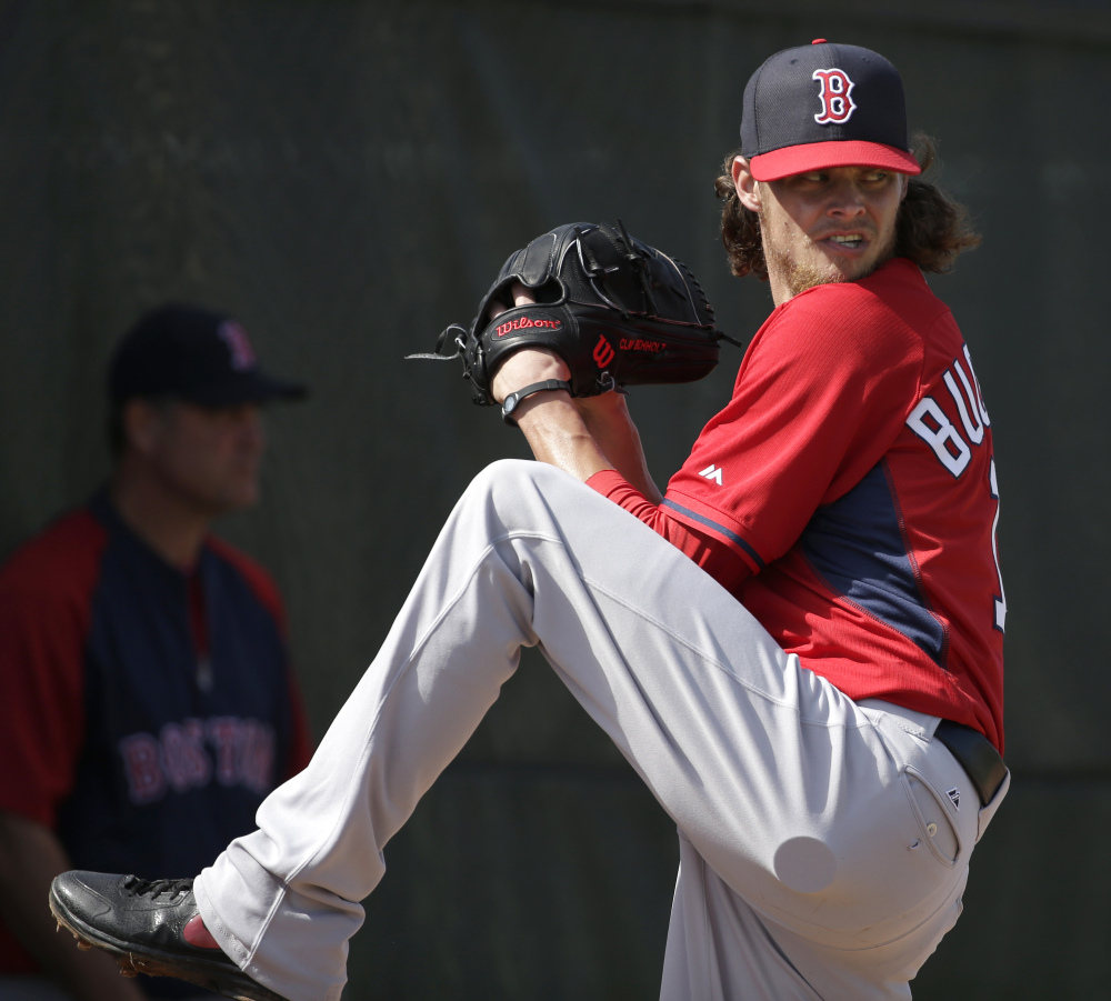 Clay Buchholz, seen during a spring training session at Fort Myers, Fla., is hoping to log a full, healthy season after an injury put a halt on his sparkling 9-0 start for Boston in 2013.
