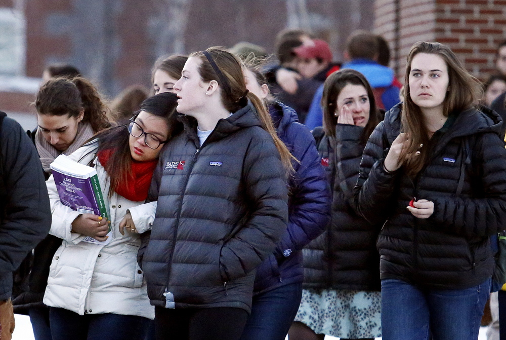 Emotions run high Monday as mourners pour out of Pettengill Hall at Bates College after a memorial service for John Durkin