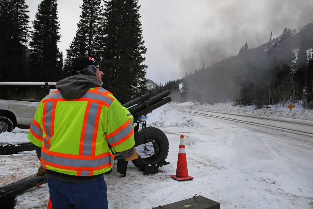 In this Feb. 21, 2014 photo, a Colorado Department of Transportation employee uses an explosives launcher to try to trigger a controlled avalanche, near Empire, Colo. Lots of new snow and strong winds in the past month have fueled dangerous conditions from the Cascades to the Rockies, prompting forecasters to issue warnings of considerable or high avalanche dangers for many areas outside of established ski areas. (AP Photo/Brennan Linsley)