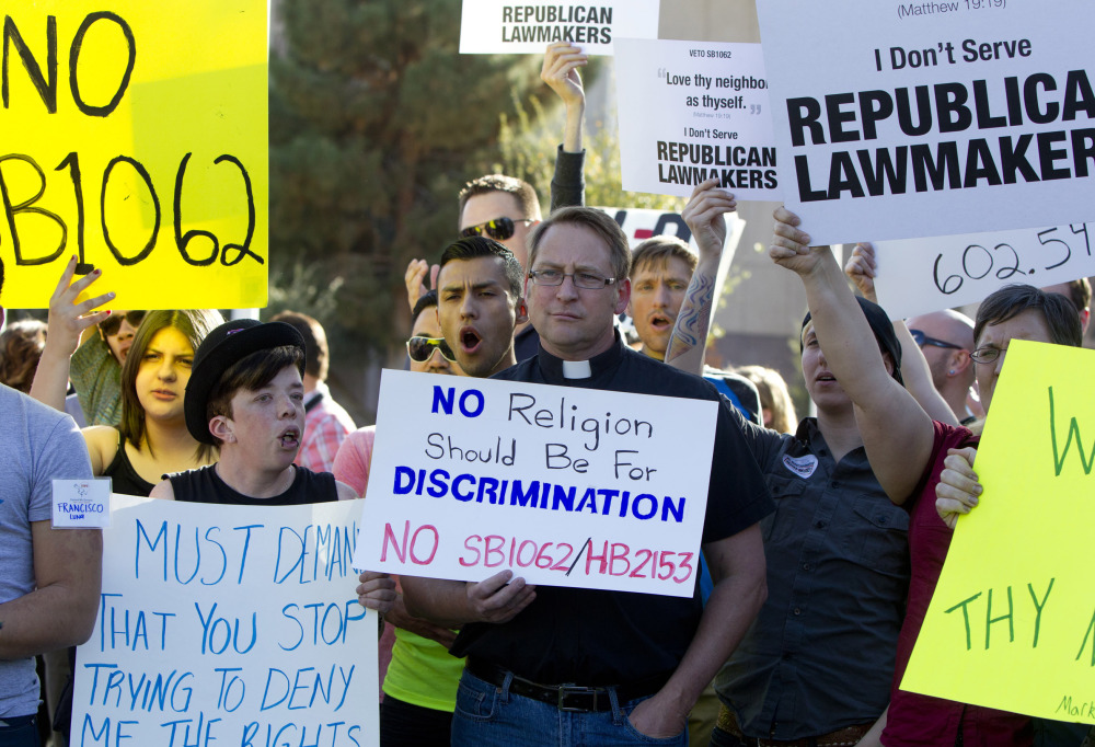 Opponents of Senate Bill 1062 rally for its veto last week at Arizona's Capitol. The bill, presented as a protection for religious freedom, was vetoed for its discrimination potential.